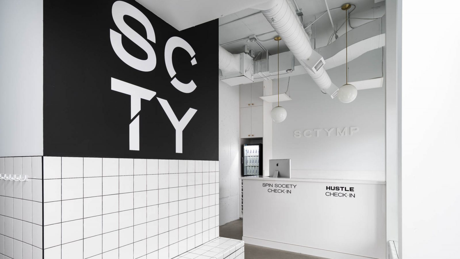 spin studio entrance with white walls